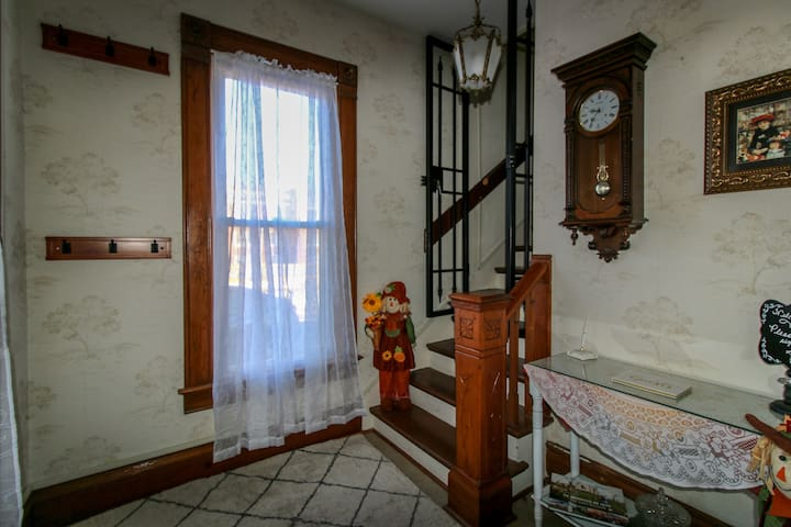 """This Foyer welcomes guests to their """"Home away from Home""""."""