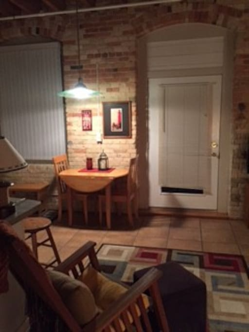 Breakfast nook with entry to porch