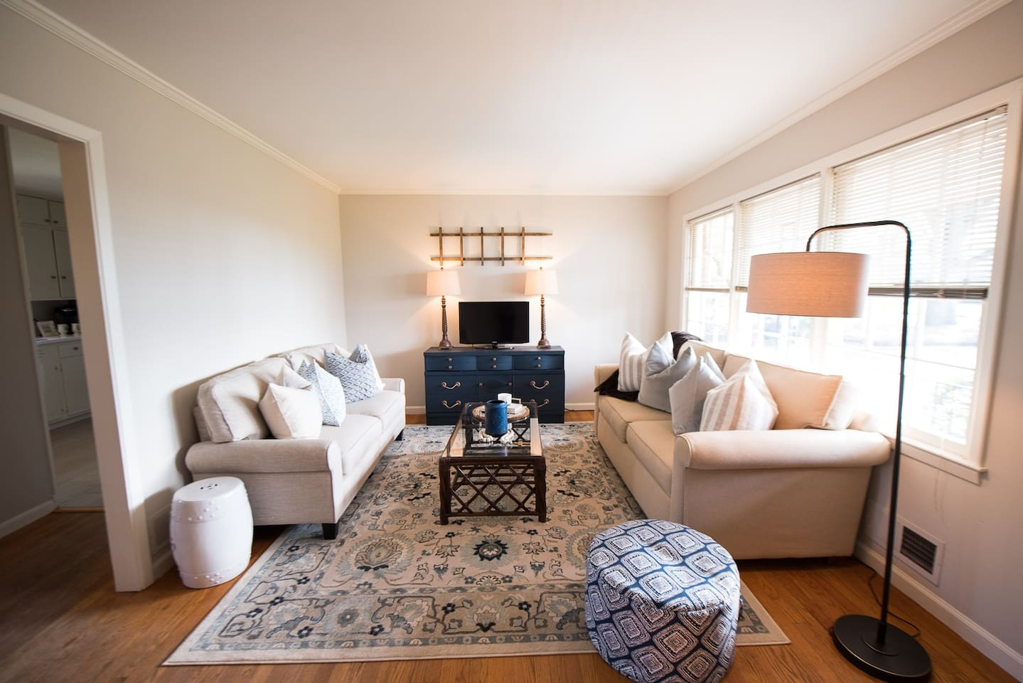 Living room offers plenty of seating in a bright & airy space. The Smart TV offers YouTube TV for access to live, local channels, as well as your favorite entertainment apps (Netflix, Hulu, etc.).