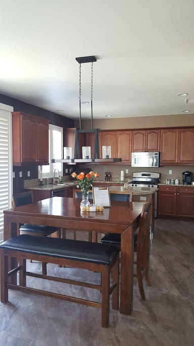 Fully equipped kitchen with Keurig and regular coffee maker, blender, dishes, utensils, glassware, spices for cooking, etc.