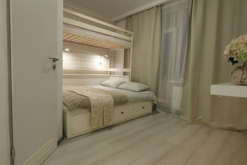 Bedroom with one double bed and loft bed