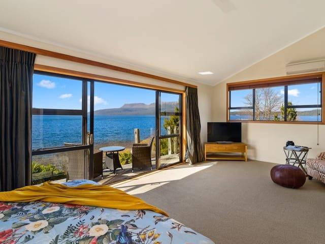 Lay in bed in the master suite and enjoy the beautiful views of the lake and mountain