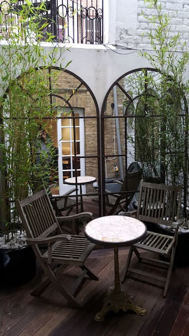 Patio - With table and chairs under 2 bamboo trees