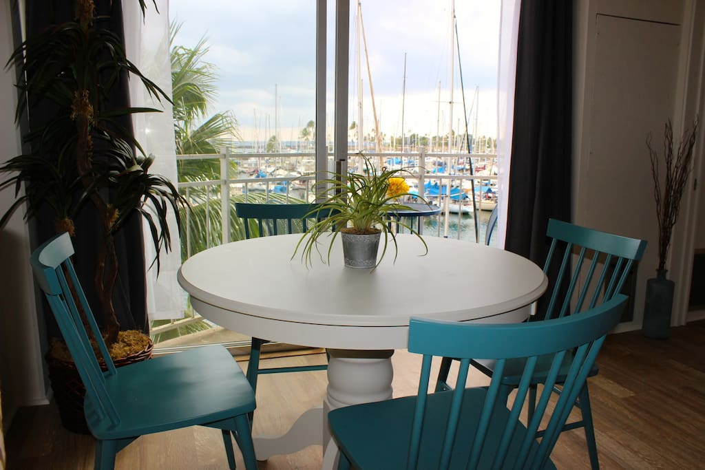 Prime dining location, comfortably seats four. Enjoy the beautiful harbor view.