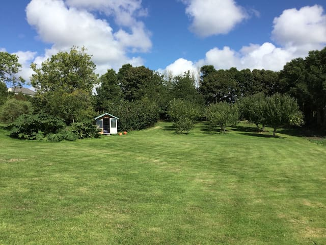 Orchard and summer house with cricket bats ,boule and rackets for outside games