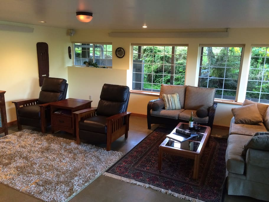 Great room with two recliners and sofa bed.