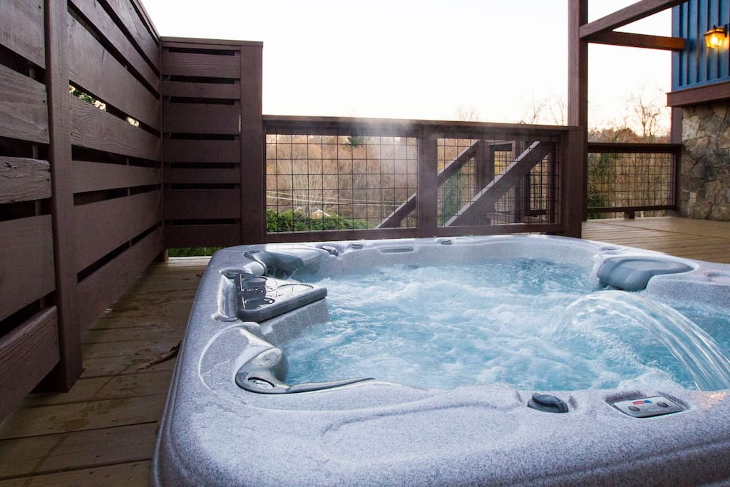 6 person hot tub with built in cooler and privacy fence which faces the sunrise over Beaucatcher Mountain.  Towels are complimentary.