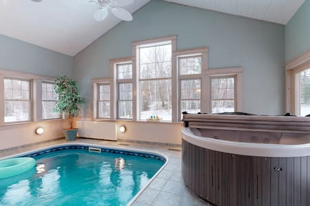 Stunning modern home w/ private indoor pool & hot tub plus fireplaces!