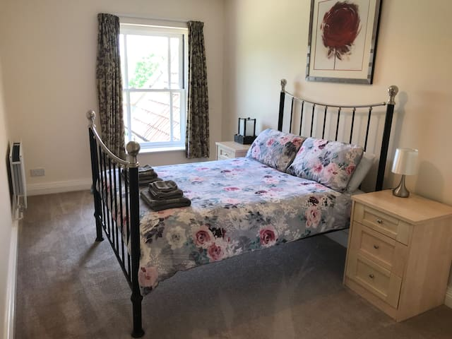 Comfortable metal framed double bed with wonderful views over the Stour valley.