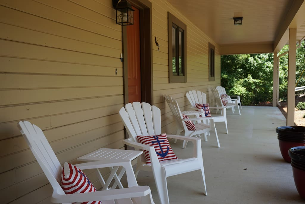 Spacious front porch with plenty of seating