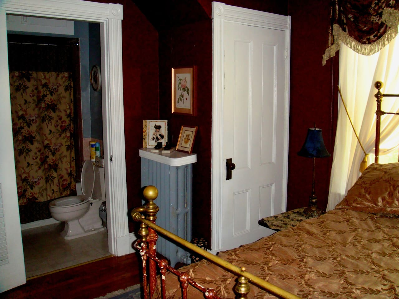 Master bedroom with antique wrought iron bed and bath ensuite.
