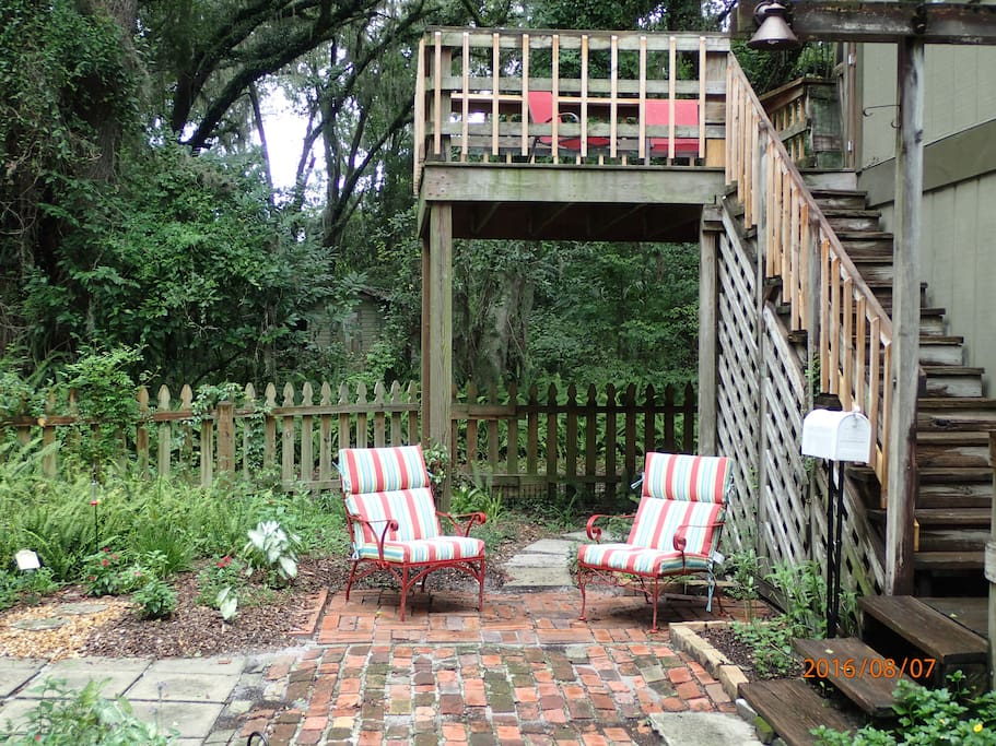 Charming brick patio with fenced butterfly garden