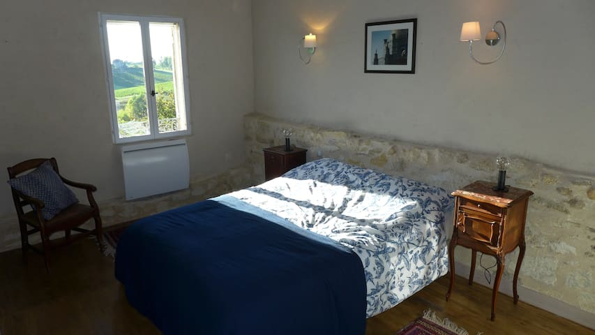 Bedroom two is a lovely light and airy room with views out over the vineyards and chateaux