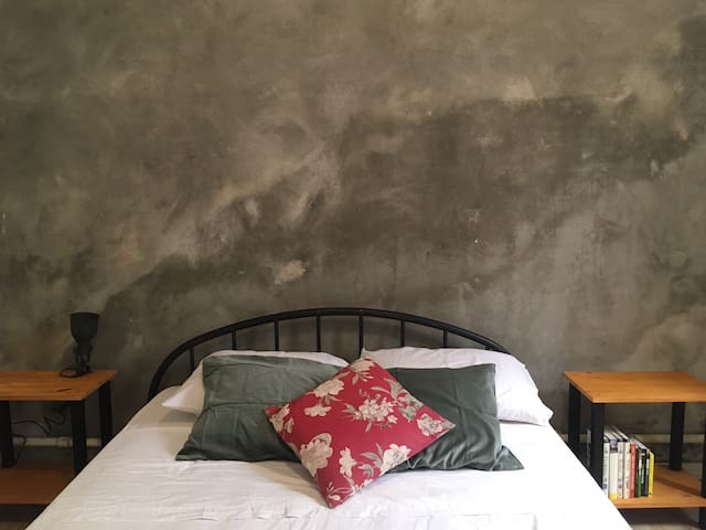 industrial style bedroom in 30's house