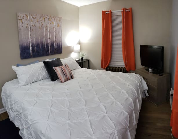 "Bedroom with a comfortable king size bed and 27"" TV equipped with Roku"
