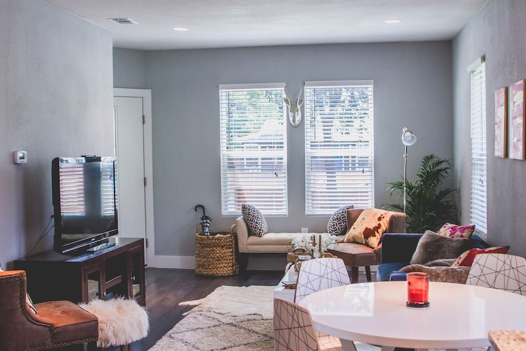 Comfortable open floor plan- family room has a cozy couch, two chairs and a bench for a place to spend time together, watch TV or play Wii. The kitchen has a dining table with four chairs, a great place to eat or work!