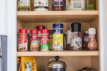 Organic coffee & teas, french press, bean grinder, instant coffee, oils, vinegars, spices, salt & cooking sundries. We love to cook & did our best to stock the cabinets with what we would like when we travel!