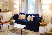 living area with queen sleeper sofa and kitchenette