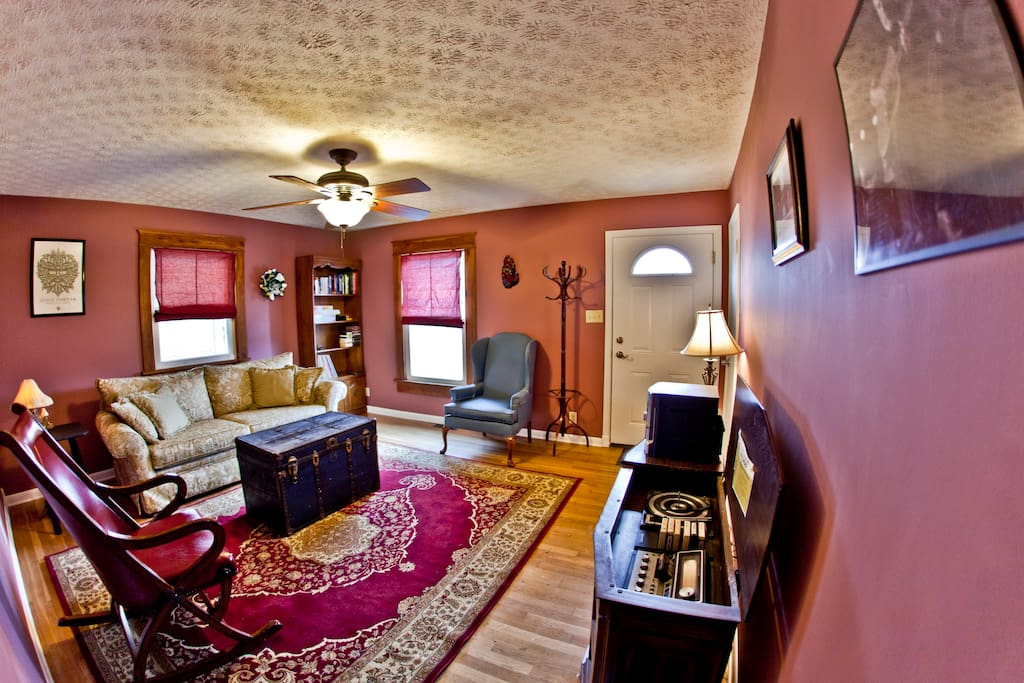 Living Room has a sofa and two chairs. Musical entertainment with CD, tape, vinyl, and 8-track player.