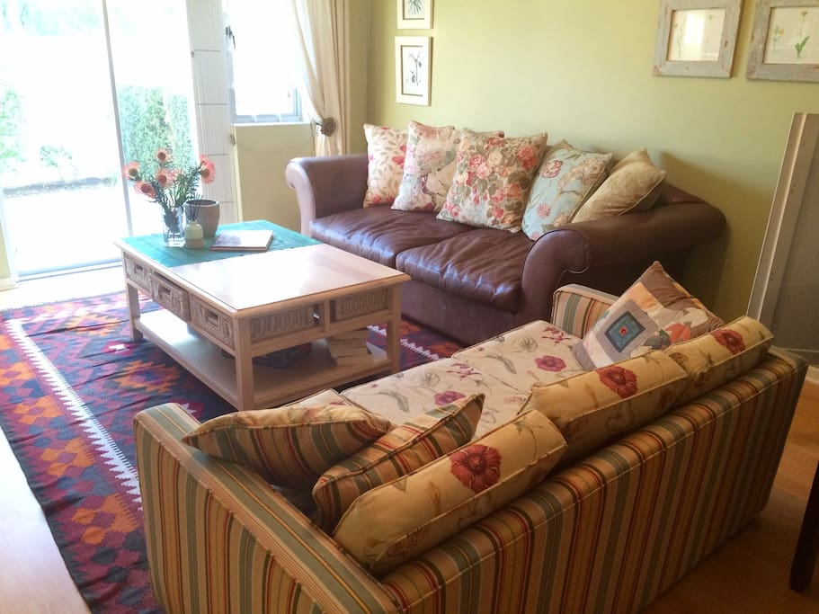 View of the lounge. Comfortable couches to read, watch TV and relax after a good day in Cape Town.