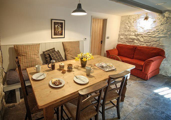 Living/dining room with large farmhouse table and underfloor heating
