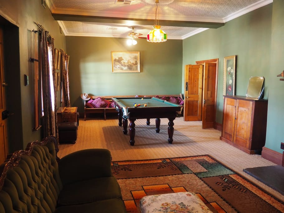 Games room with billiard table and  television.