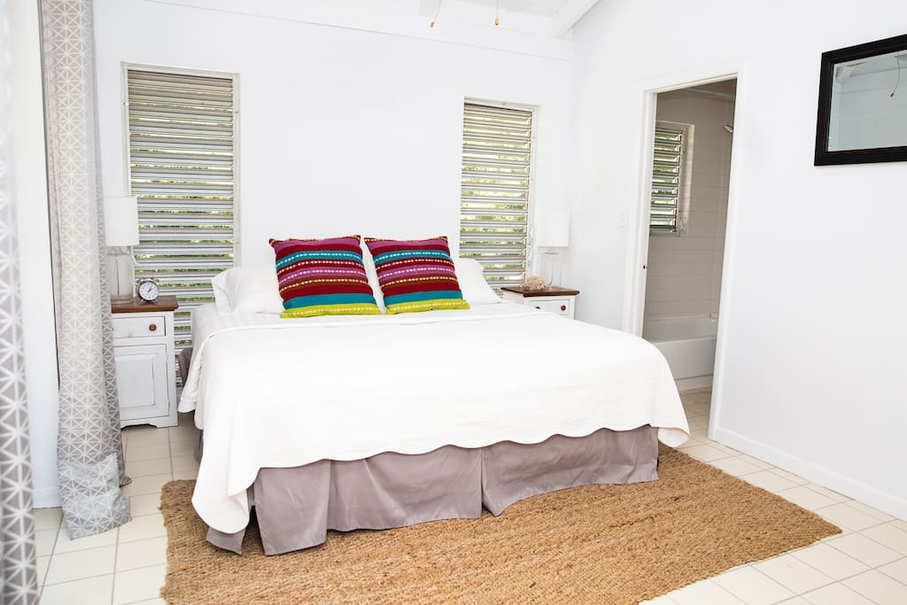 Master Bedroom king size bed, full ensuite bathroom and entry to balcony
