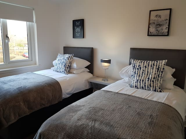 Comfortable single beds with wardrobe