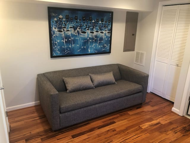 Private basement room with full bath. Sofa pulls out into Queen Sleeper. I have added a gel mattress topper for extra comfort.