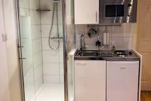 Private shower, kitchenette ( Hob, microwave, fridge)