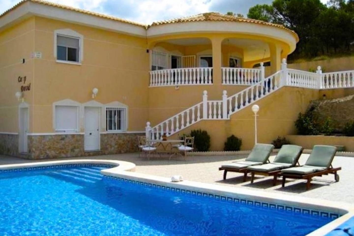 Only Ground floor is for rent! The entrance in separate apartment is a white door on this photo  Owners are living on upper flor (family with a child). The swimming pool will be shared only with Owners... Sunbeds are for our guests ( people who is renting)