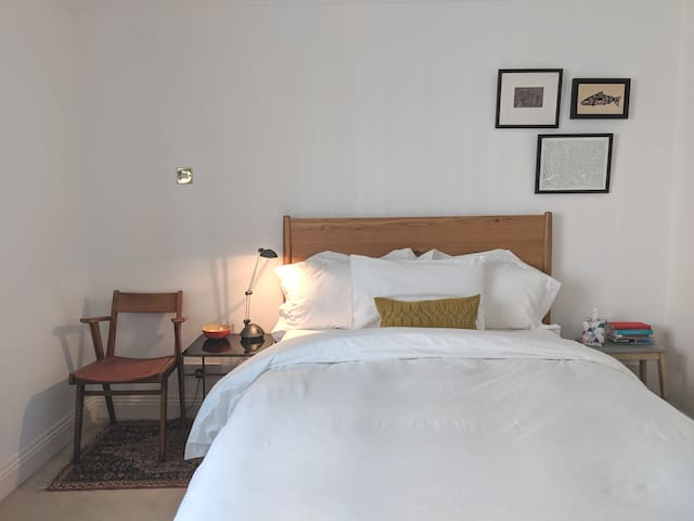 Bright central room with private bath + breakfast
