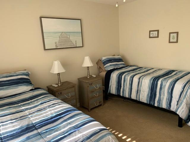 Bedroom 2 has  two electric adjustable twin beds and small closet and dresser.