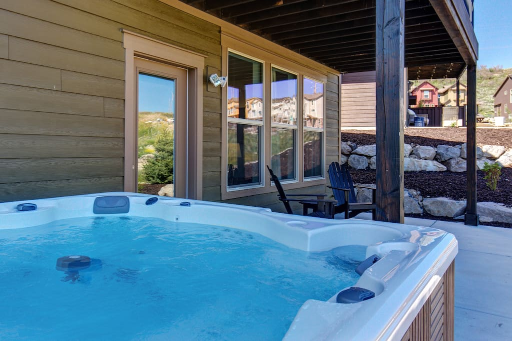 Relax in the bubbly hot tub just outside