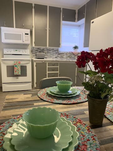 Kitchen from breakfast nook table. All set with jade dishes.
