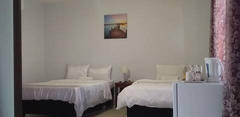 En suite modern family room in guest house- ROOM 2