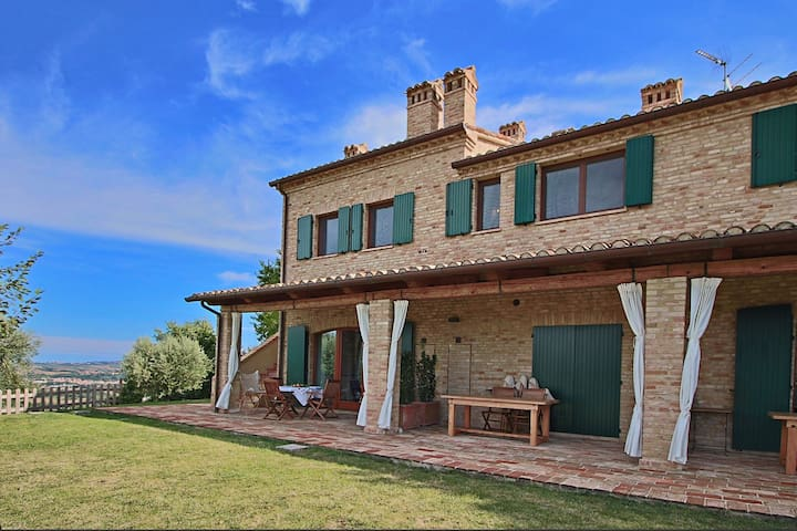 Country house with 4 apartments surrounded by green, private terrace and shared pool