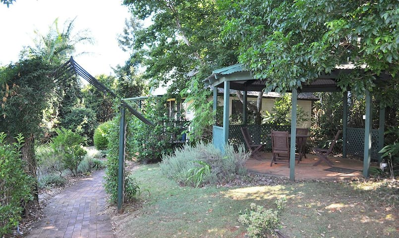 Private Entrance and gazebo with an outdoor dining and sitting area