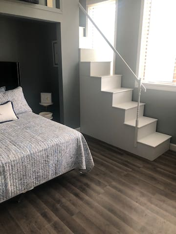 This bedroom is a sister favorite.  The top loft is cushy and comfy for both adults and kids to lounge or sleep.  Its the perfect getaway without really getting away.  Safety rails and sturdy stairs make it safe and inviting!
