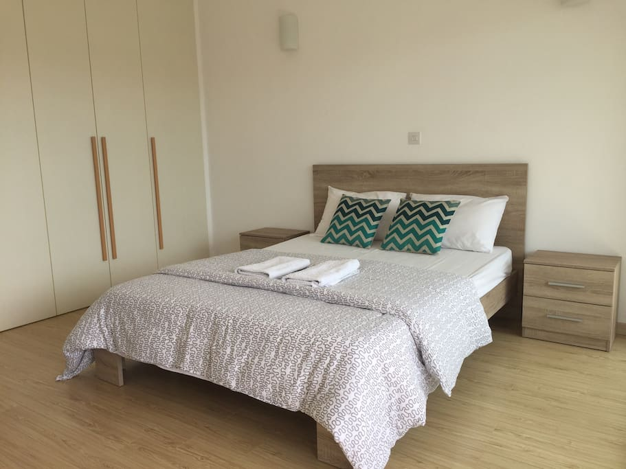 Master bedroom with fresh bed linen and towels
