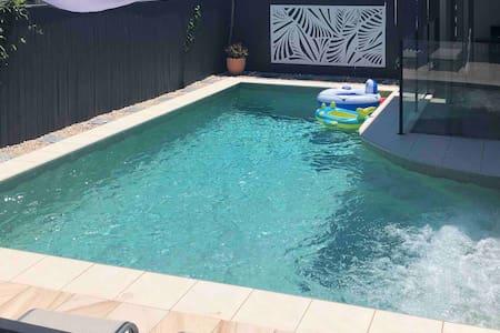 Pristine beach, private heated pool & pet friendly