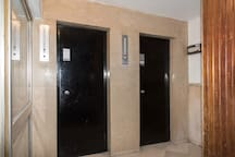 Two elevators in the building entrance to go to the 3rd floor