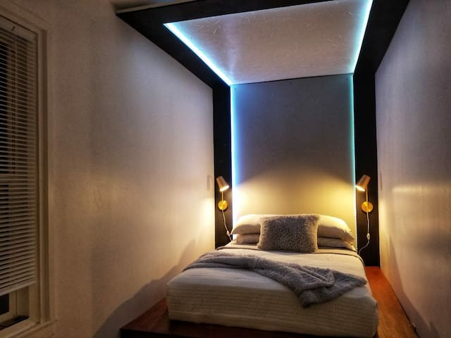 The second queen bedroom is a hand built platform bed with LED mood lighting built in a canopy!