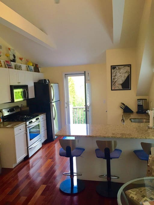 Kitchen with granite island, open concept