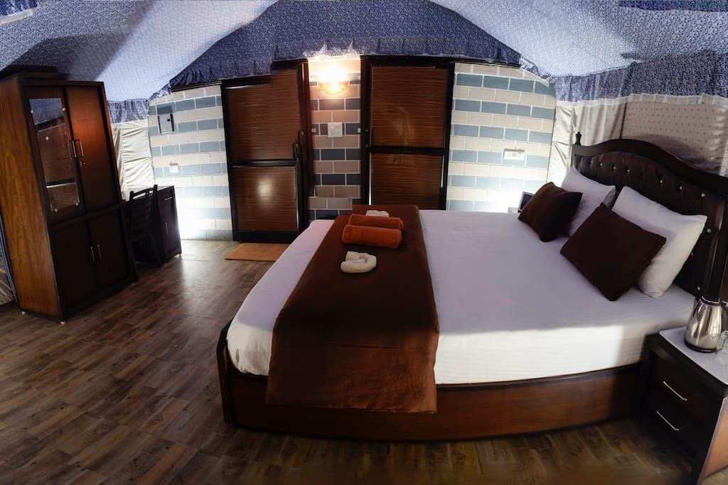 Private wardrobe, study table, chair, side tables along with the most comfortable outdoor beds for a GOOD NIGHT sleep!