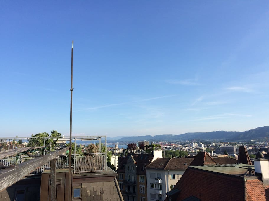 Spectacular view over the head of Zurich into the Alps and the lake of Zurich