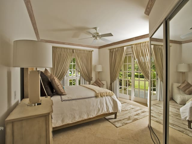 The lovely master bedroom with a king bed and en-suite bathroom