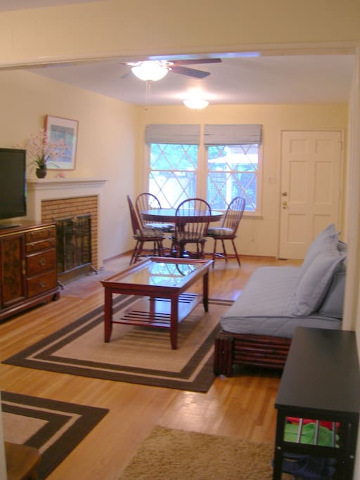 Living room and dining area to back yard