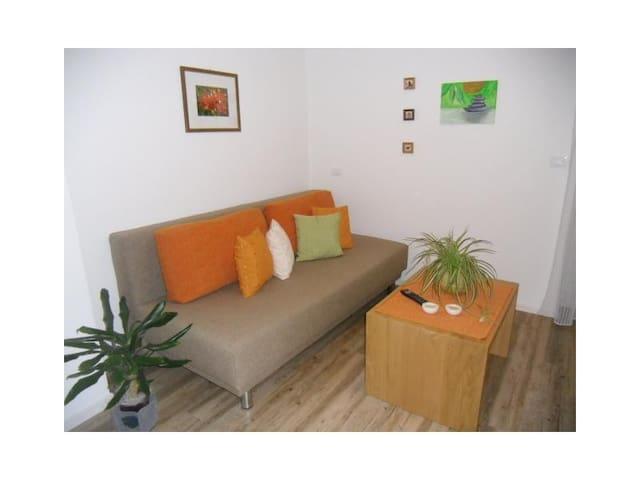 Wohnzimmer Kastanie..gemütliche Sitzecke