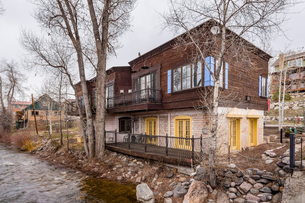 The charming exterior with a view of the creek.
